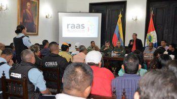 Afectos al régimen de Nicolás Maduro sostienen un encuentro a propósito del fortalecimiento de las RAAS en el estado de Yaracuy, en mayo de 2018.