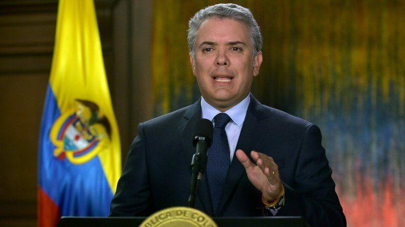 Fotografía cedida por la Presidencia de Colombia, del mandatario, IvánDuque, durante una alocución televisada este viernes, en Bogotá (Colombia).