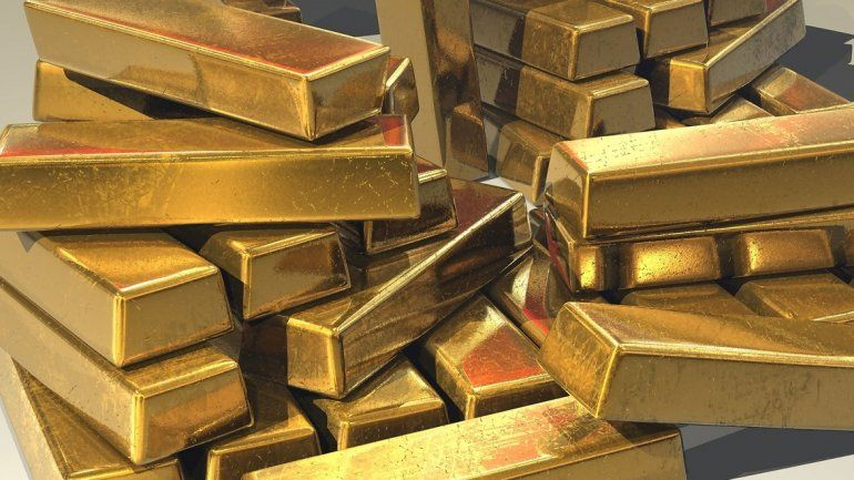 Vista de un grupo de lingotes de oro.