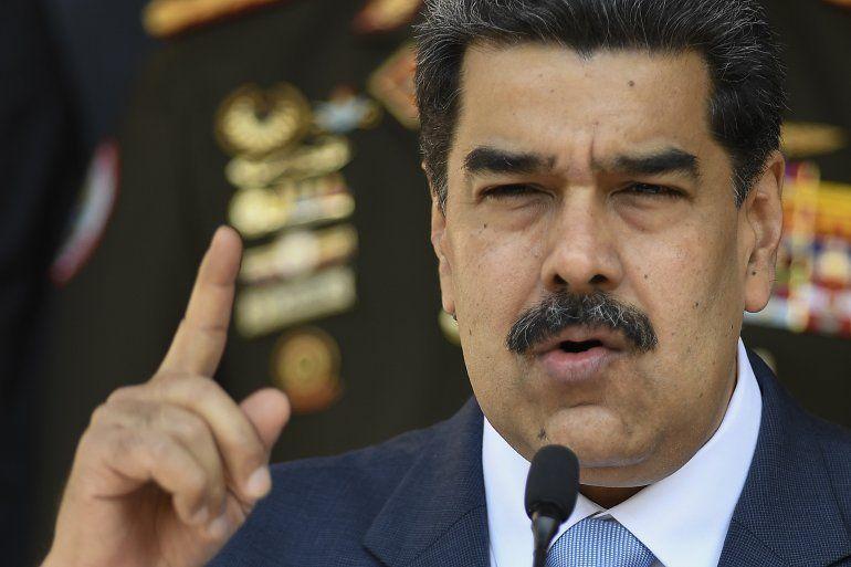 En esta fotografía de archivo del 12 de marzo de 2020, el dictador venezolano Nicolás Maduro ofrece una conferencia de prensa en el Palacio de Miraflores en Caracas, Venezuela.