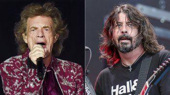 Mick Jagger, vocalista de The Rolling Stones, durante una presentación en East Rutherford, Nueva Jersey el 1 de agosto de 2019, izquierda, y Dave Grohl de los Foo Fighters durante una presentación en el Pilgrimage Music and Cultural Festival en Franklin, Tennessee el 22 de septiembre de 2019.