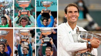 Esta combinación de imágenes creada el 11 de octubre de 2020 muestra al español Rafael Nadal posando con la Copa Mousquetaires (Los Mosqueteros) durante sus trece victorias en el Abierto de Tenis de Francia masculino en el estadio de Roland Garros. Nadal posa con sus trofeos (de arriba a abajo) el 5 de junio de 2005; el 11 de junio de 2006; el 10 de junio de 2007; el 8 de junio de 2008; el 6 de junio de 2010; el 5 de junio de 2011; el 11 de junio de 2012; el 9 de junio de 2013; el 8 de junio de 2014 y el 11 de junio de 2017, el 10 de junio de 2018, el 9 de junio de 2019 y el 11 de octubre de 2020.