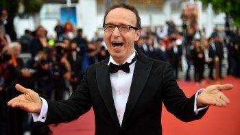 En esta foto de archivo tomada el 13 de mayo de 2018, el actor y director italiano Roberto Benigni reacciona en la 71 edición del Festival de Cine de Cannes en Cannes, sur de Francia. El italiano será honrado con un premio a su carrera en el Festival de Cine de Venecia de este año.