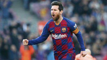 En esta foto del sábado 22 de febrero de 2020, Lionel Messi celebra tras anotar un gol para el Barcelona en el partido contra el Eibar en La Liga española.