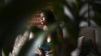"""La activista de género independiente venezolana Andrea Hernández, de 26 años, habla en su casa sobre el movimiento Yo si te creo que nació en Venezuela con respecto a los escándalos de abuso sexual, en Caracas el 7 de mayo de 2021 Violencia sexual en Venezuela , lejos de estar contenido, en declive, va en aumento """", dice Abel Saraiba, coordinador de Cecodap, una ONG que defiende los derechos de la niñez y la adolescencia."""