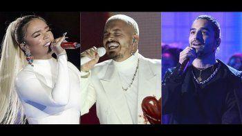 En esta combinación de fotos, de izquierda a derecha, Karol G, J Balvin y Maluma, quienes cuentan con múltiples nominaciones al Premio Lo Nuestro 2021. La ceremonia de premios, en su 33ra edición, es el jueves 18 de febrero.